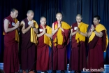 Buddhist monks and Nuns from Emory University's Tenzin Gyatso Science Scholar Program perform a prayer chant about developing friendship and unity among practitioners of different disciplines.