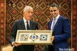 President of the Ismaili Council for Portugal, Rahim Firozali, offers a replica Ismaili Centre tile to the President of the Portuguese Republic Marcelo Rebelo de Sousa. ,