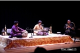 Aga Khan Master Musicians, Homayoun Sakhi, Abbos Kosimov, and special guest, Nitin Mitta, performing at the concert.