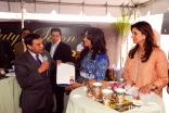 Rozina Piredina receiving an award from Ali Sajjad Taj, Mayor of Artesia, California.