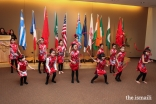 The Girl Scouts perform traditional dances representing their assigned country.