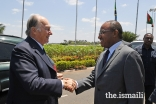 Mawlana Hazar Imam is greeted by Tanzania's Defence Minister Hon. Hussein Mwinyi upon his arrival at Julius Nyerere Airport before departing Tanzania.