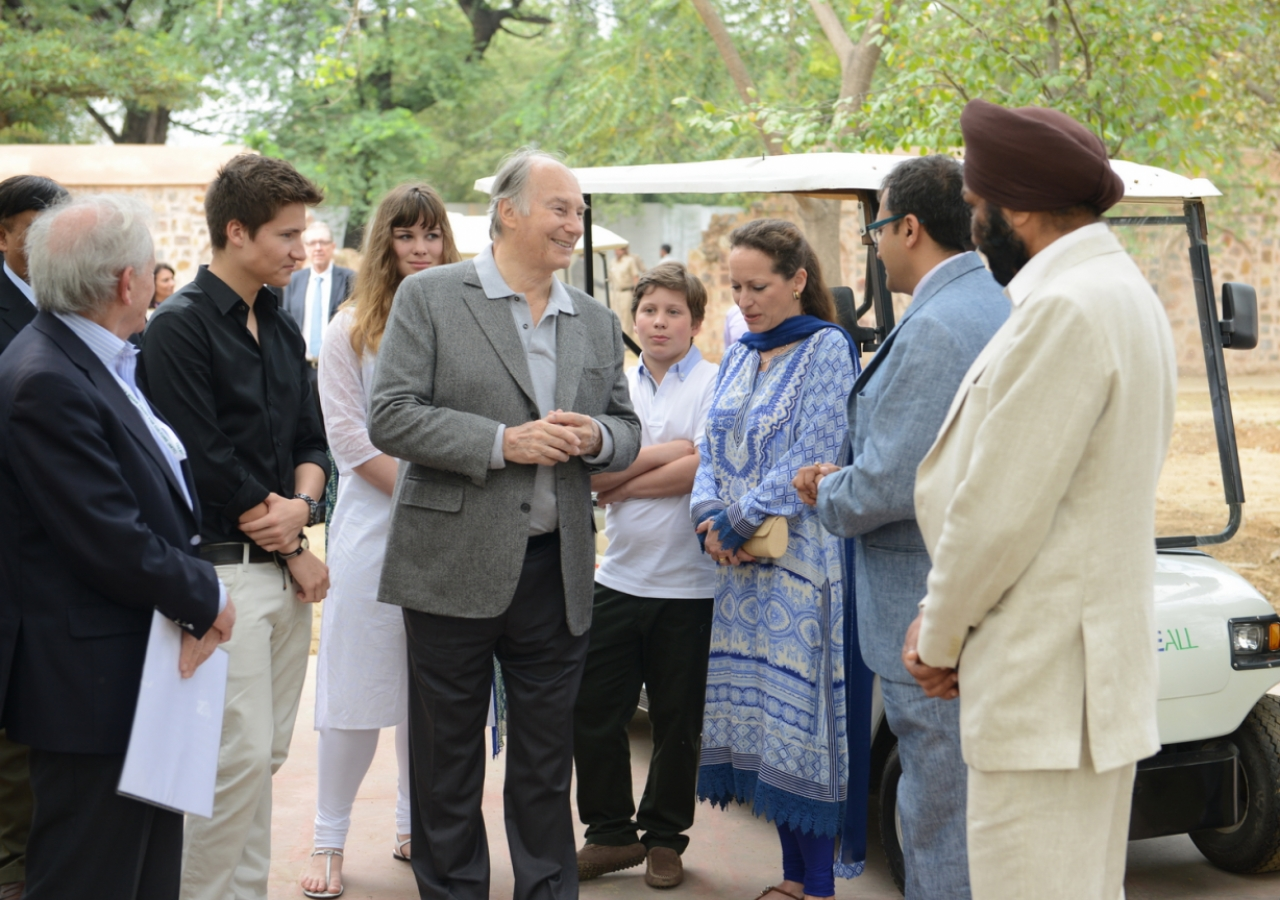 Mawlana Hazar Imam speaking with AKTC staff in 2015 after touring the Sundar Nursery and Batashewala complex with Prince Aly Muhammad, Princess Zahra and her children, Sara and Iliyan.