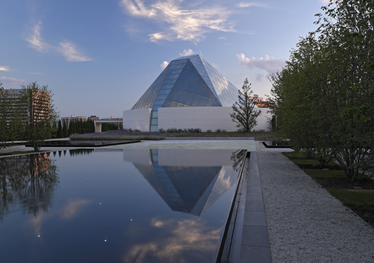 Charles Correa has revisited and reinterpreted the traditional notions of a dome by playing with light, colour and symmetry to give the Ismaili Centre a unique glass crystalline dome. Gary Otte