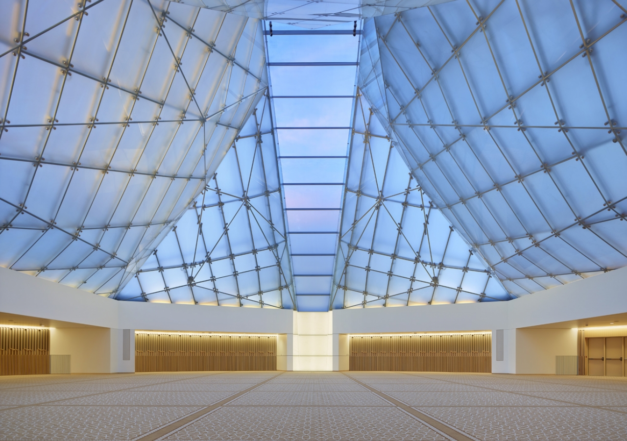 Inside the Jamatkhana, the central skylight panel descends to a white translucent onyx block. Shai Gil