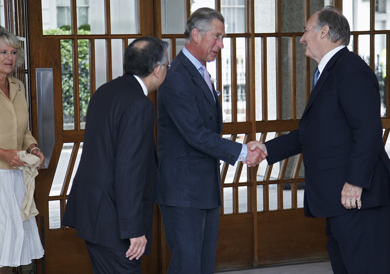 Mawlana Hazar Imam greeting Their Royal Highnesses the Duchess of Cornwall and the Prince of Wales at the Ismaili Centre, London, 12 July 2007.