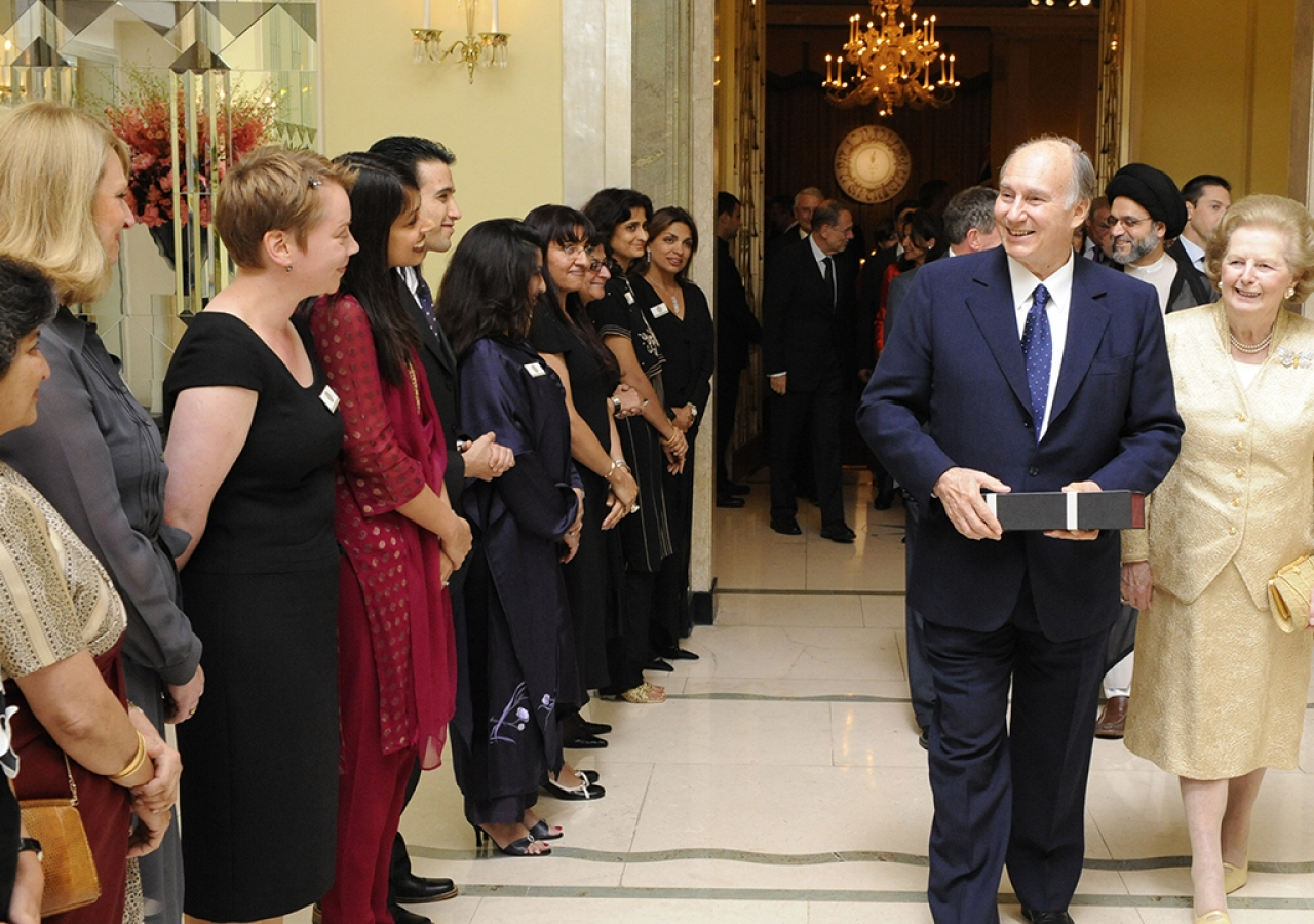 Flanked by Baroness Margaret Thatcher, former British Prime Minister, Mawlana Hazar Imam bids farewell to volunteers after the Imamat Dinner, London, 3 July 2008.