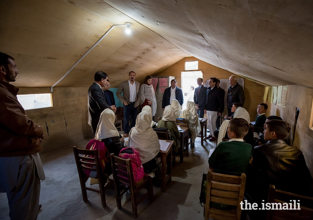 Prince Rahim and Princess Salwa with students and teachers in a classroom at the community-managed middle and secondary school in the village of Bilhanz located in Immit, Ishkoman Valley, Ghizer District in Gilgit-Baltistan. Prince Rahim and Princess Salwa also visited the adjacent Diamond Jubilee Primary School Bilhanz, which is operated by the Aga Khan Education Services (AKES).