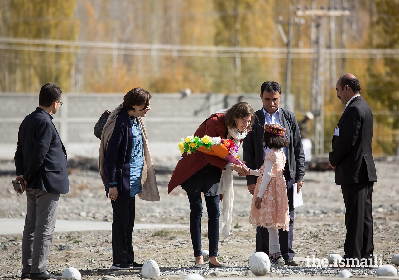 Princess Salwa being presented with flowers upon arrival in Gahkuch, Punial Valley, Ghizer District in Gilgit-Baltistan. During their stay in Gahkuch, Prince Rahim and Princess Salwa visited the Aga Khan Higher Secondary School Gahkuch, which is operated by the Aga Khan Education Services (AKES).