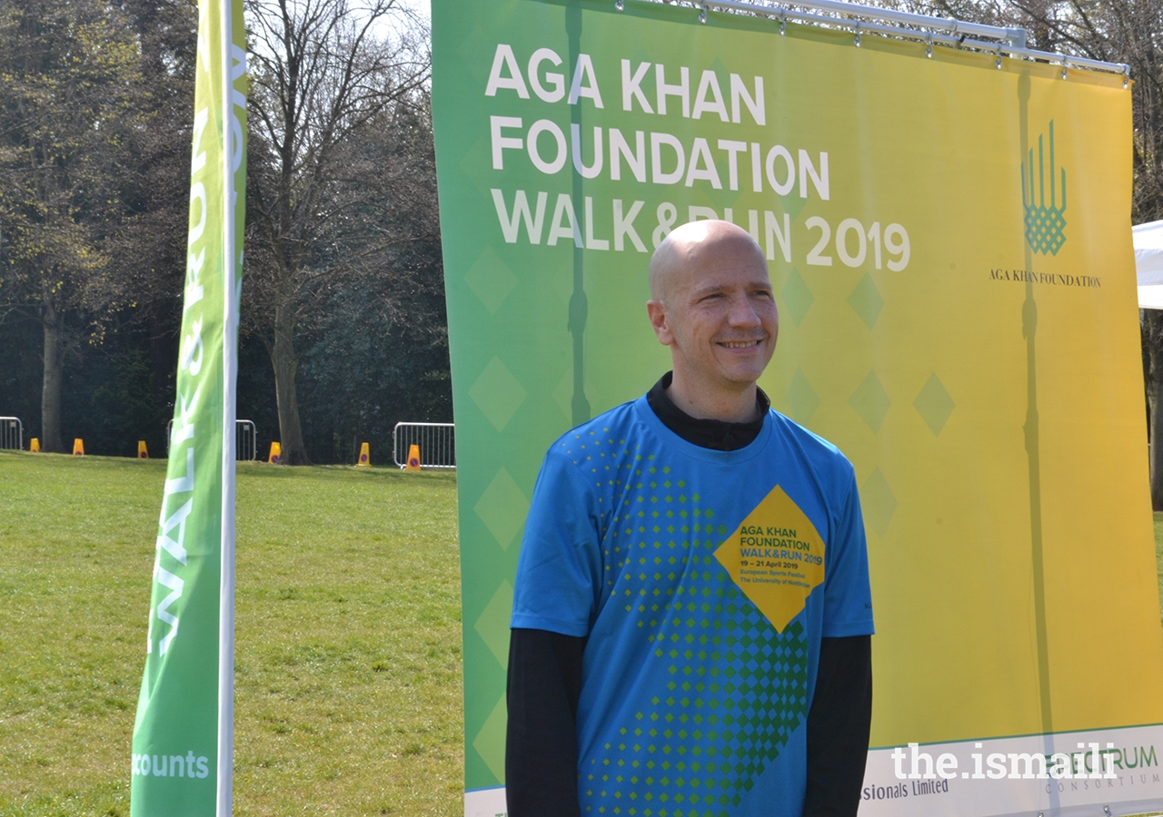 Matt Reed, CEO of the Aga Khan Foundation (UK), welcomes participants and spectators to the AKF Walk and Run, held during the European Sports Festival 2019.