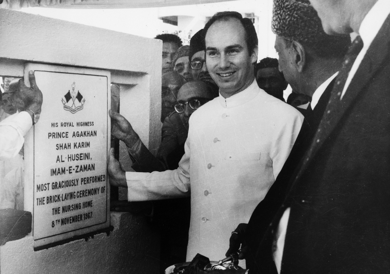 Mawlana Hazar Imam performing the brick-laying ceremony for the nursing home of Prince Aly Khan Hospital, then known as Ismailia General Hospital, Bombay. (Mumbai, 1967) Studio La Bella
