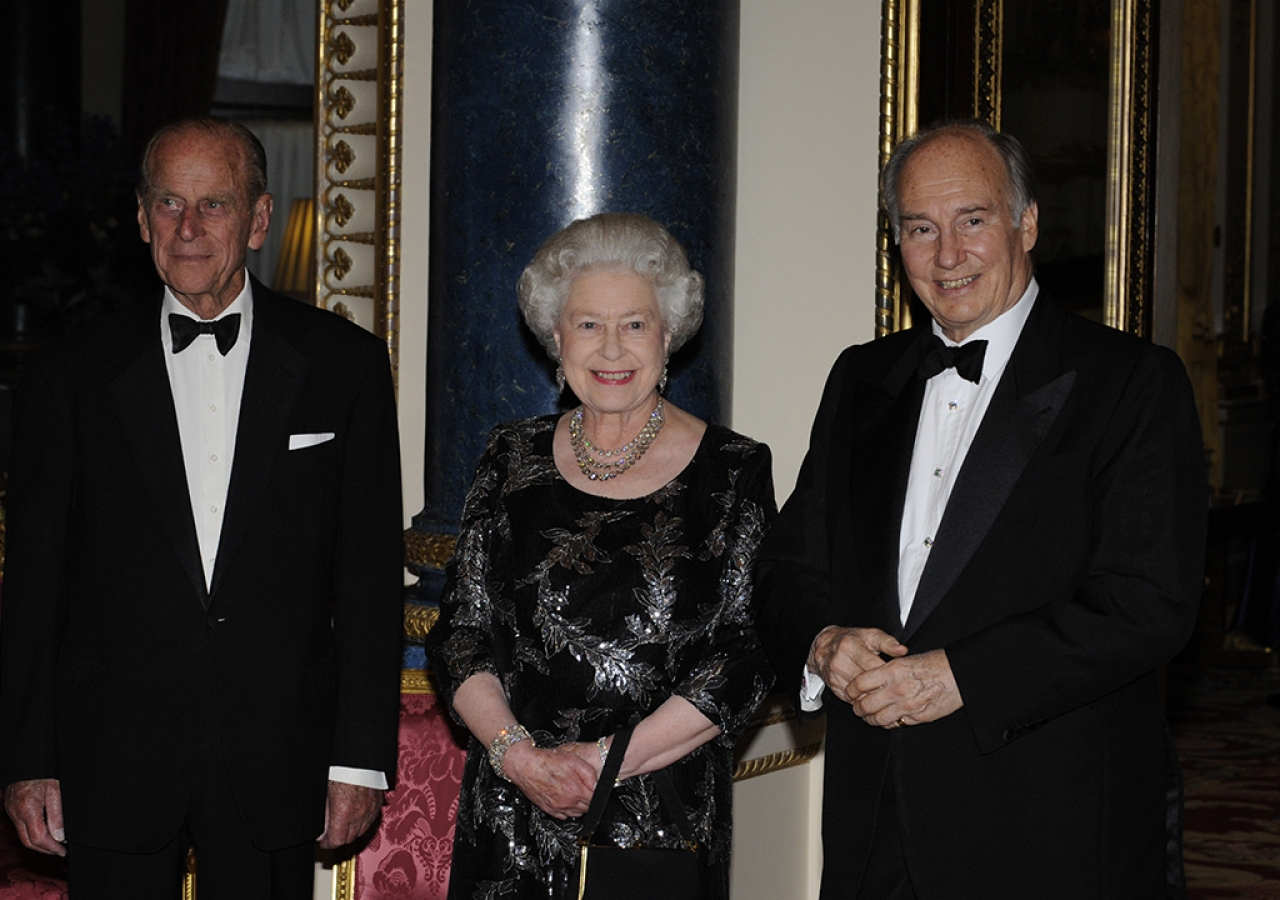 Mawlana Hazar Imam together with Her Majesty the Queen and His Royal Highness The Duke of Edinburgh, Prince Philip, during a dinner hosted in honour of Mawlana Hazar Imam at Buckingham Palace to commemorate his Golden Jubilee, London, 7 July 2008.