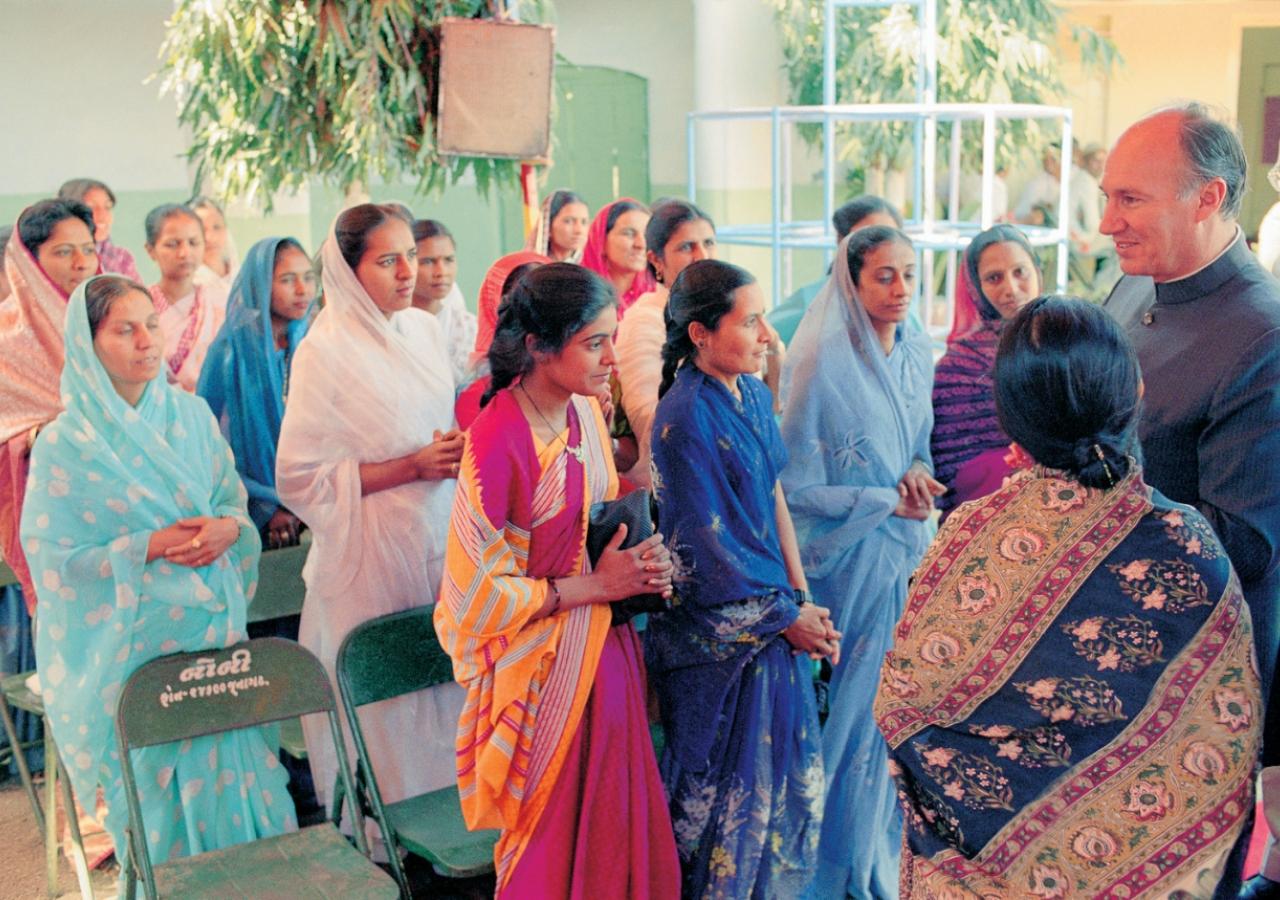 Mawlana Hazar Imam visiting the Malia Hatina Day Care Centre in Gujarat. (Malia Hatina, 1989)  AKDN / Gary Otte