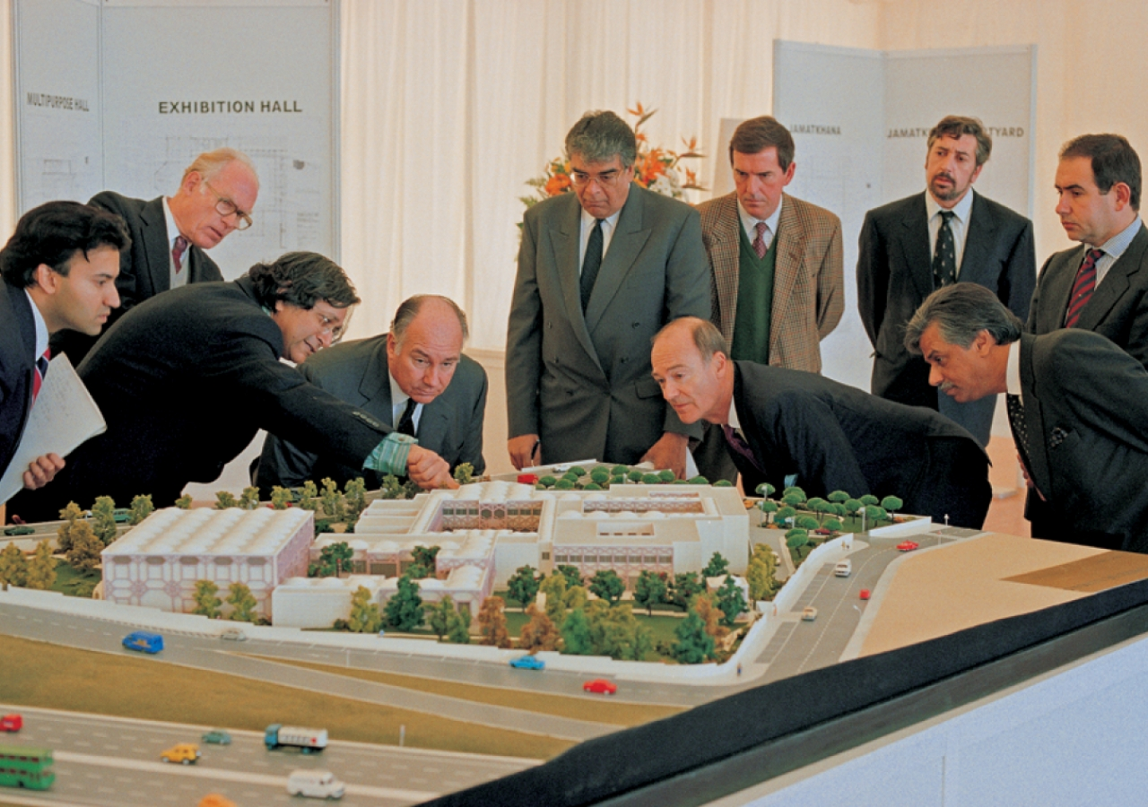 Mawlana Hazar Imam and Prince Amyn carefully examine the model of the Ismaili Centre, Lisbon, as architect Raj Rewal points out certain features of the building.