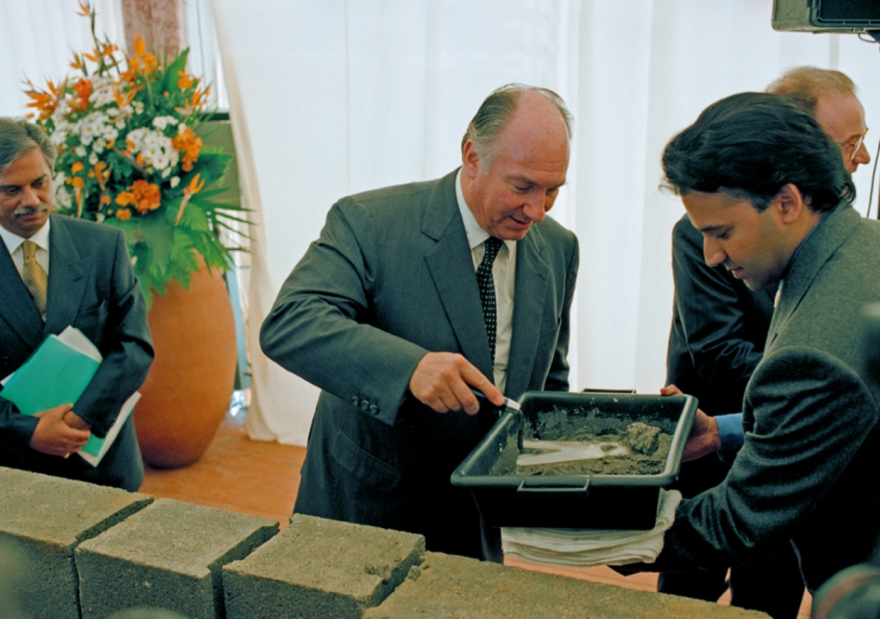 Mawlana Hazar Imam applies cement to brick as part of the Foundation Ceremony of the Ismaili Centre, Lisbon.