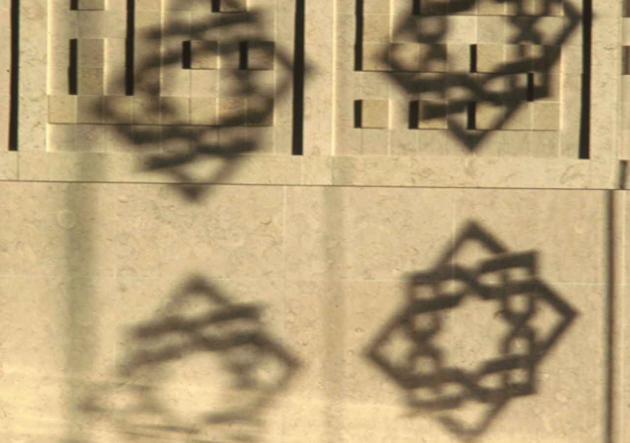 Calligraphy, dappled by the motif.