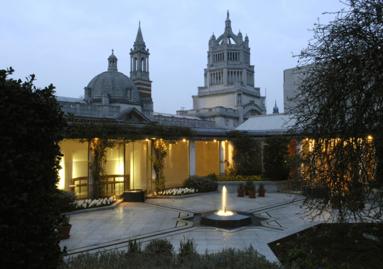 The Roof Garden by night showing the central fountain connected by radial channels to the four corner pools.