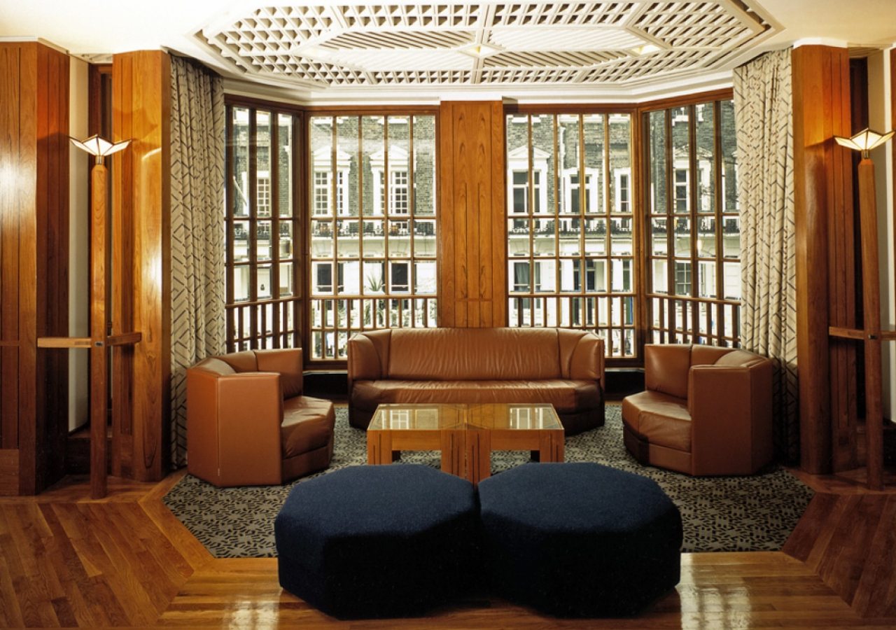 The geometric designs and symmetry are visible in the décor and furnishings in the Social Hall.