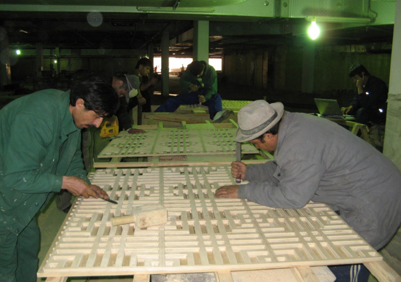 April 2009: Local craftsmen work on the latticed wood panels.
