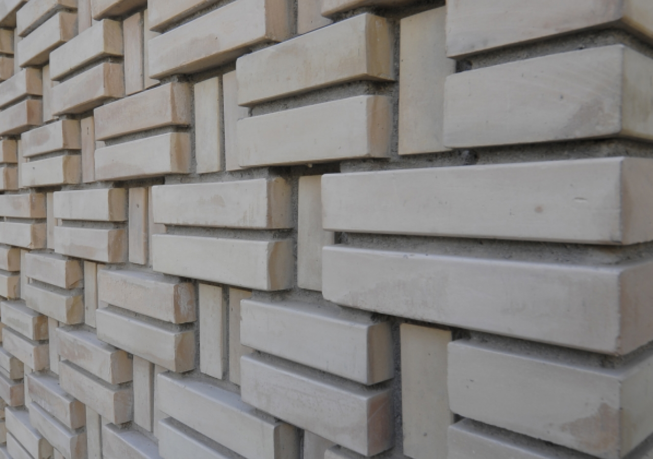 Clay bricks, woven in a variety of patterns, are the most distinctive aspect of the complex.