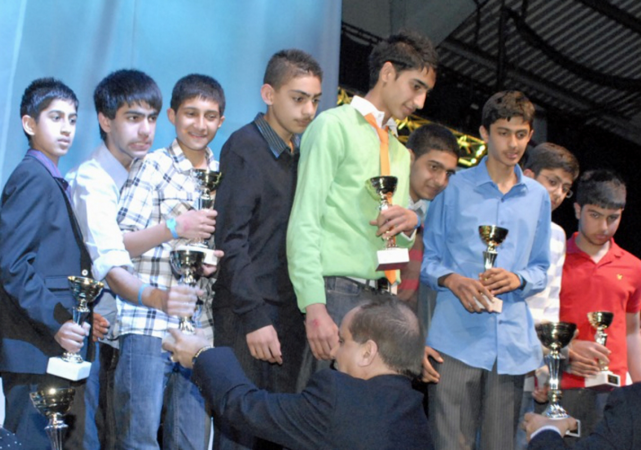 Under-16 Football participants receive their trophies.