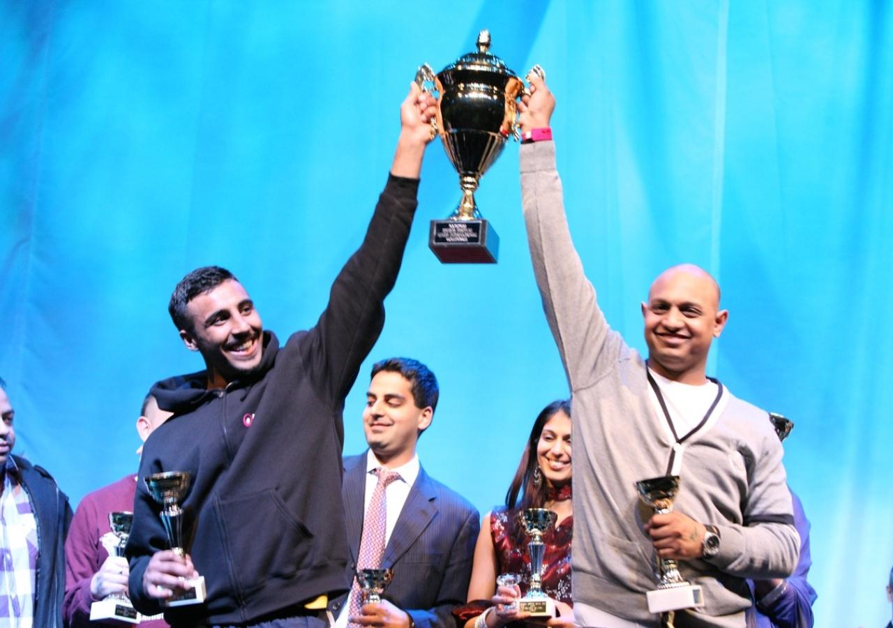International Volleyball winners receive their trophy.