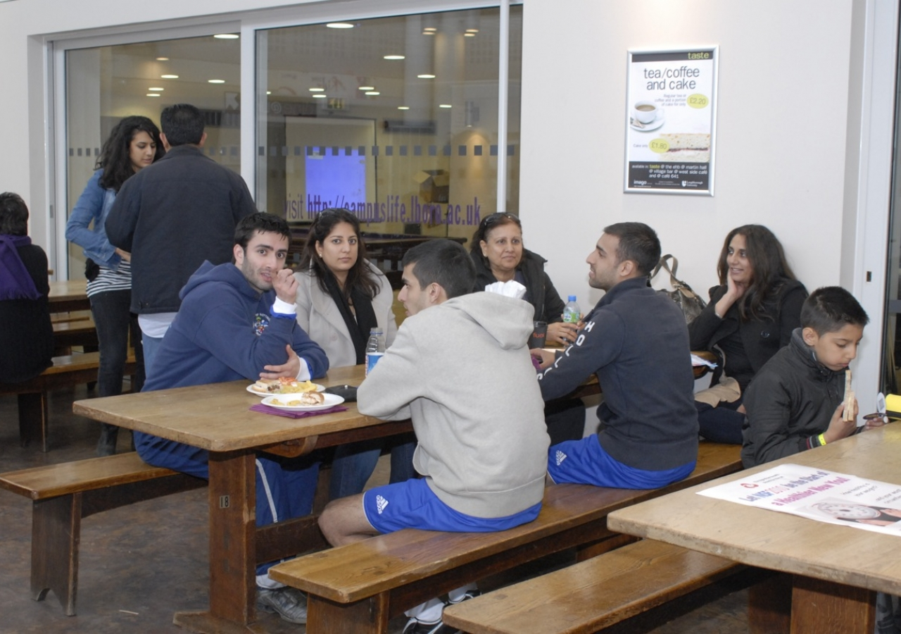 Participants enjoy a meal while relaxing with family and friends.