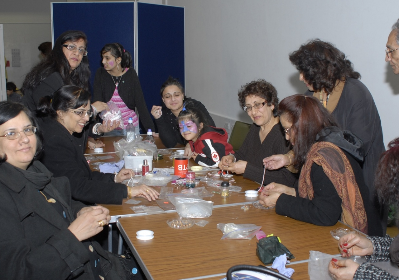Members of the Jamat of all the ages get together at the tasbih-making class.