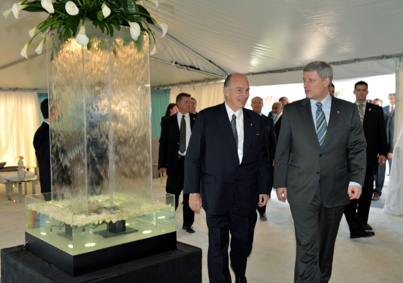 Arriving at the Wynford Drive site for the Foundation Ceremony, Mawlana Hazar Imam and Prime Minister Stephen Harper walk through the Welcome Tent.