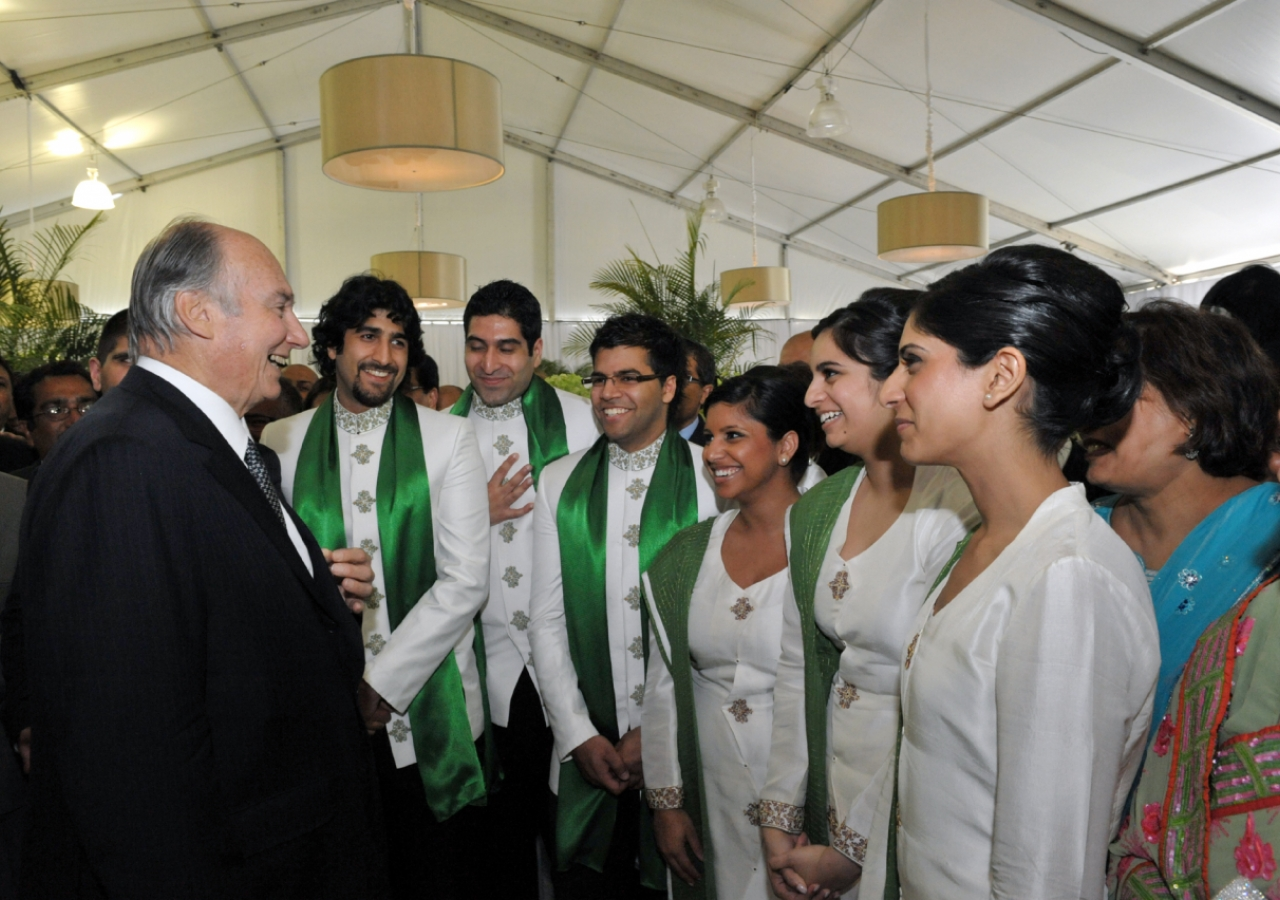 Mawlana Hazar Imam speaks with members of the Canadian Ismaili Muslim Youth Choir, who had performed earlier in the afternoon.