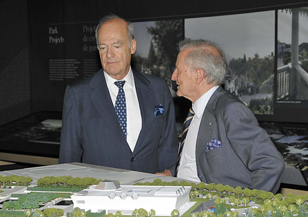 Prince Amyn and Luis Monreal, General Manager of the Aga Khan Trust for Culture, discuss the architectural model of the Ismaili Centre, the Aga Khan Museum and their Park.