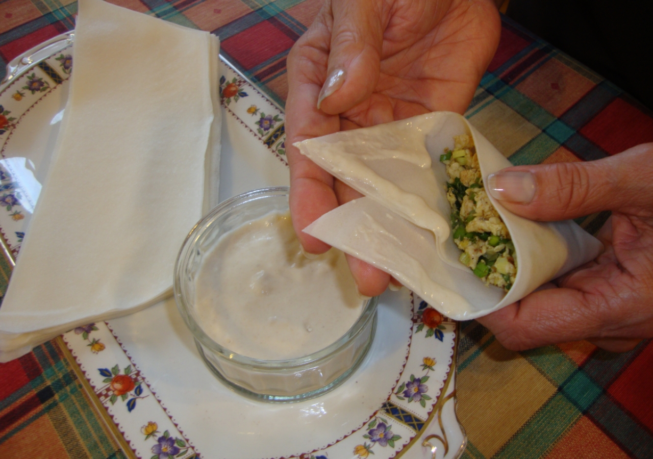 "10. Hold the samosa in one hand and gently fold over the ""lid"" making sure that you leave no holes at the corners."