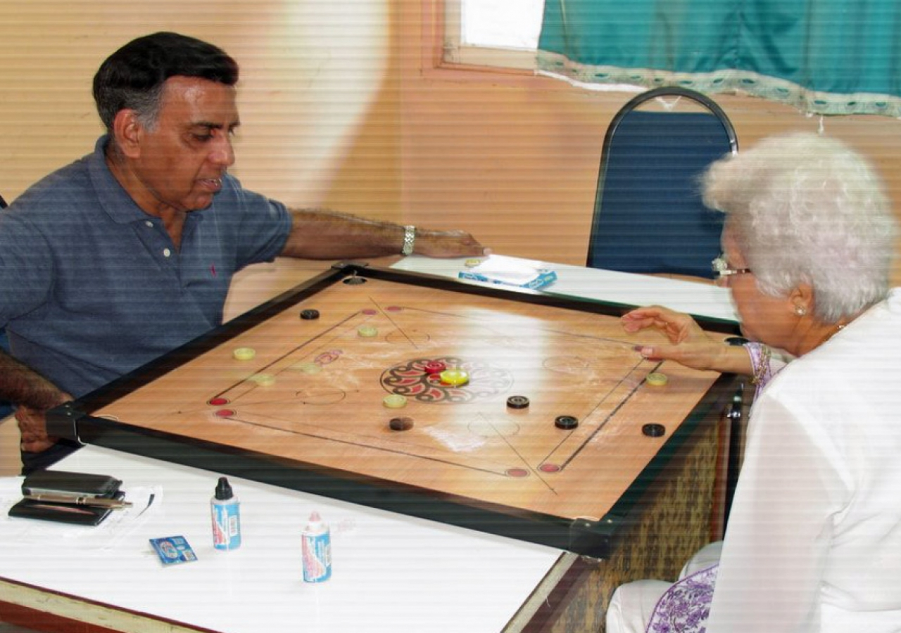 Seniors enjoying a game of carrom at the Far East Jamati Sports Day held in Penang.