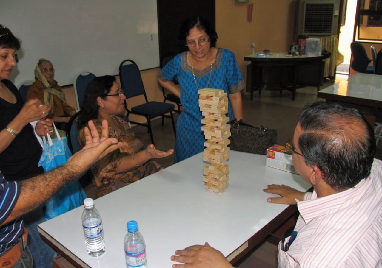 At the Penang Sports Day, a Jamati member contemplates how to make her next move without toppling the precarious Jenga tower.