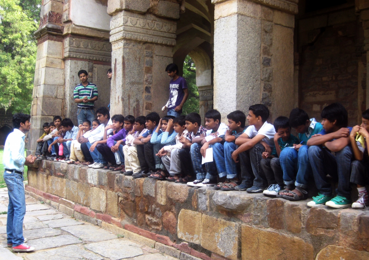 AKTC-trained heritage volunteers from Nizamuddin Basti teach young children about their rich cultural heritage at the 16th century Isa Khan tomb.