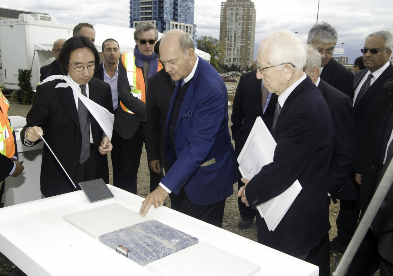 Fumihiko Maki and Gary Kamemoto of Maki & Associates review materials for the exterior finish of the Aga Khan Museum with Prince Amyn in October 2010.