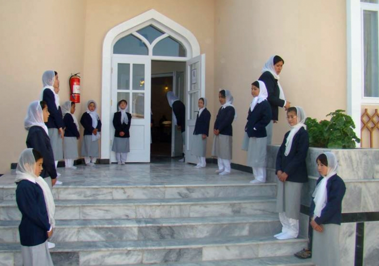 Volunteers line up outside Qargha Jamatkhana in Kabul for its official opening.