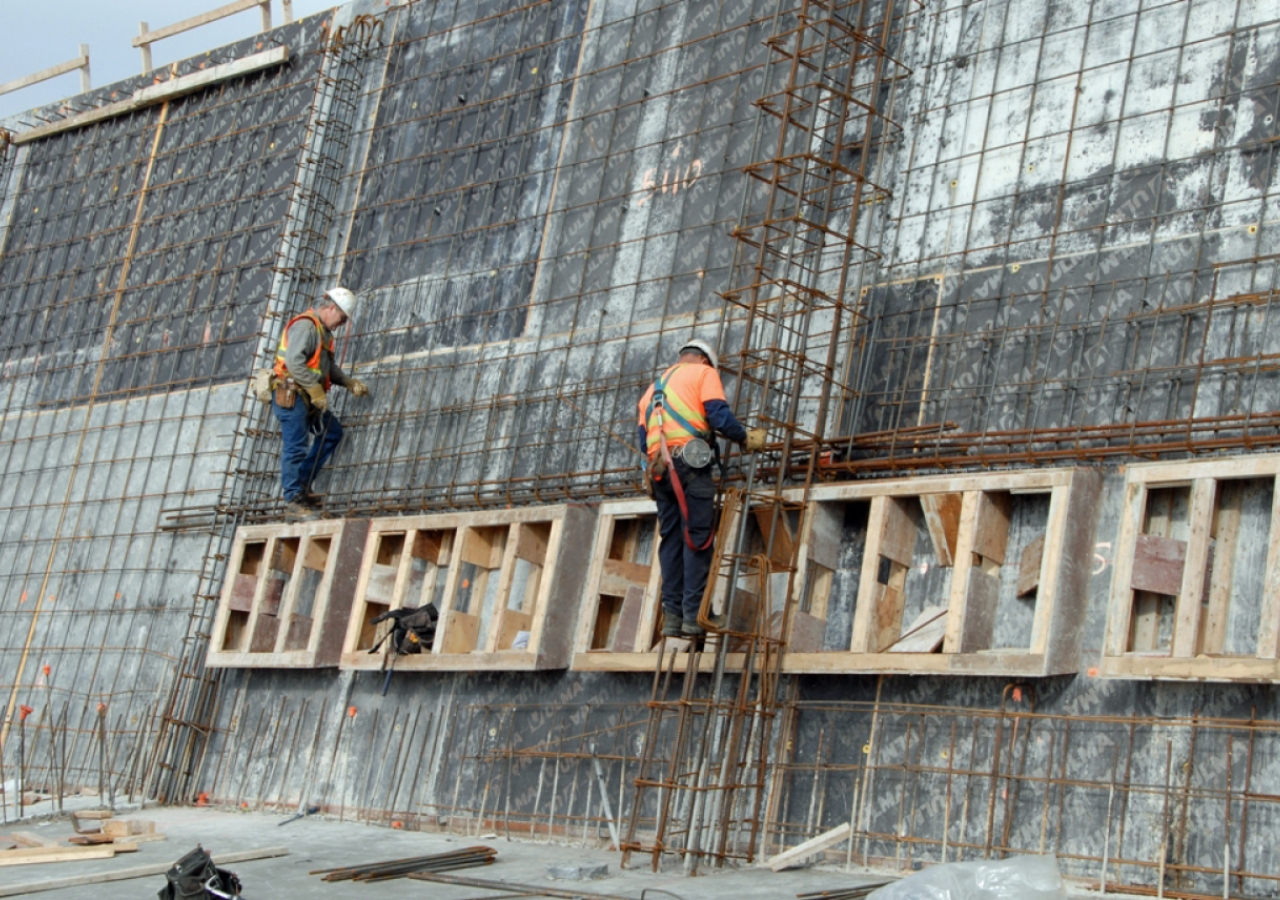 May 2011: Construction workers inspect reinforcing steel and window frames before concrete is poured in the walls of the Aga Khan Museum.