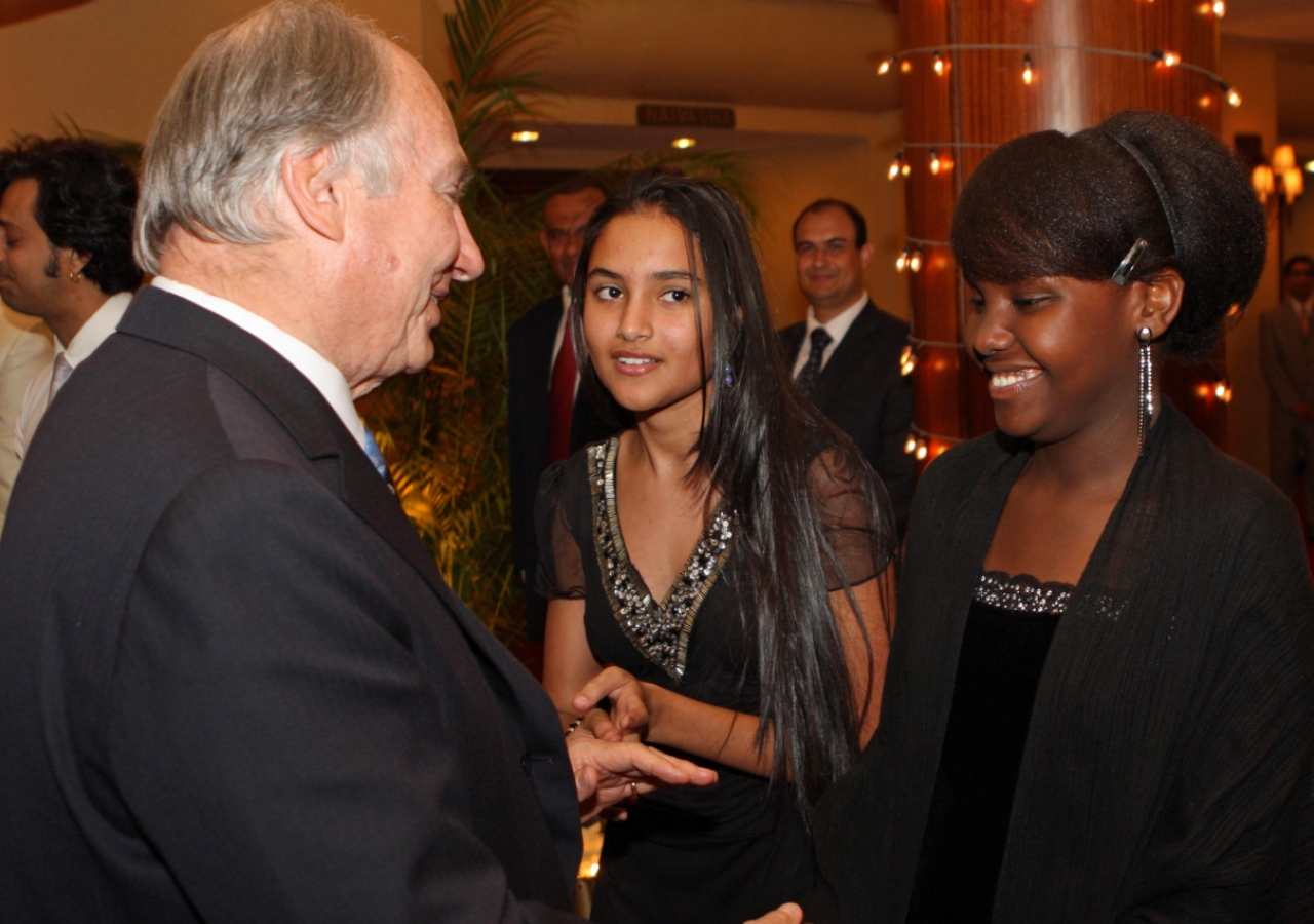 Mawlana Hazar Imam greets performers from the Aga Khan Academy, Nairobi, following the Jamati Institutional Dinner.