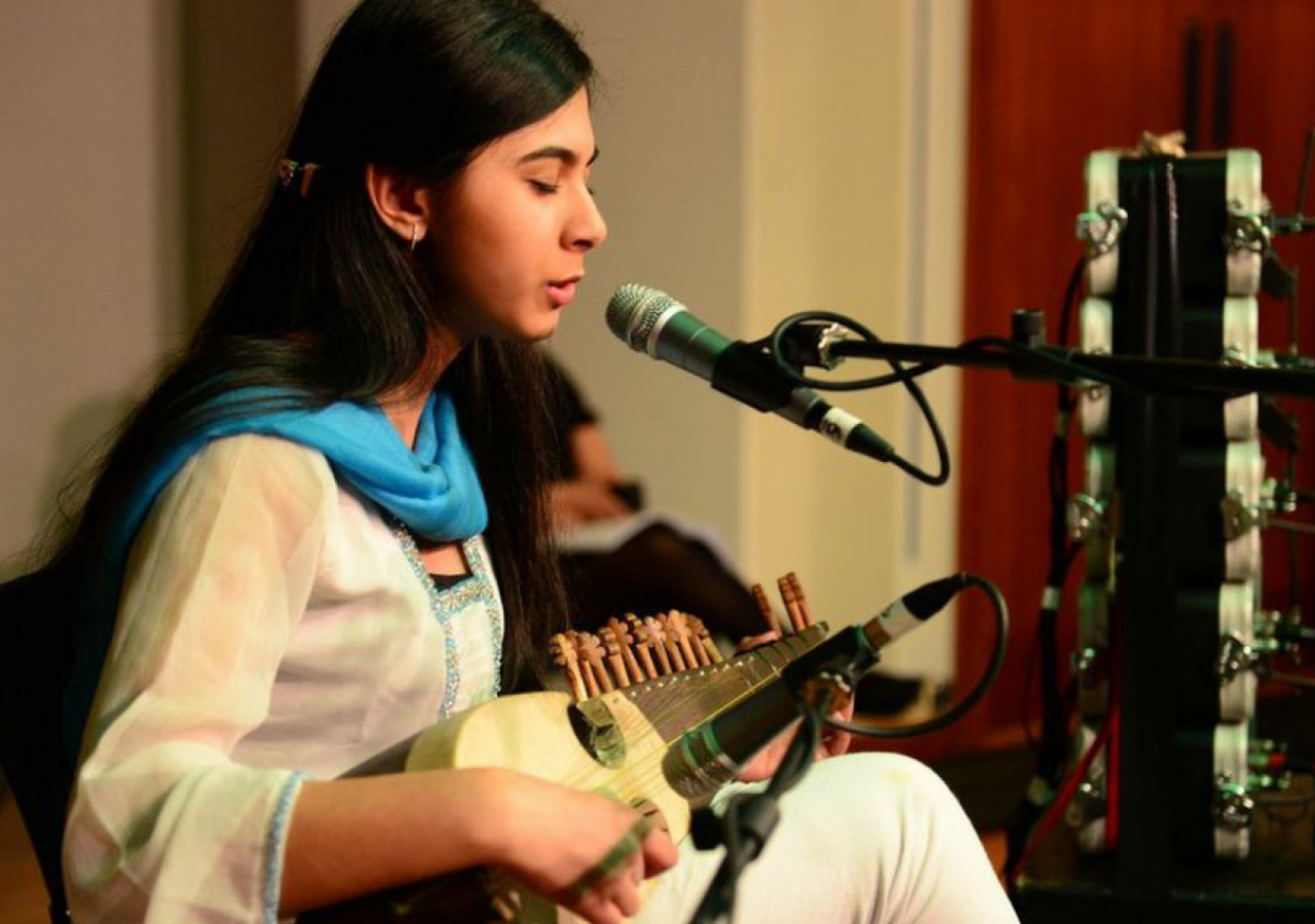 A moving qasida is performed on the rubab — a traditional Central Asian instrument revered in Sufi poetry.
