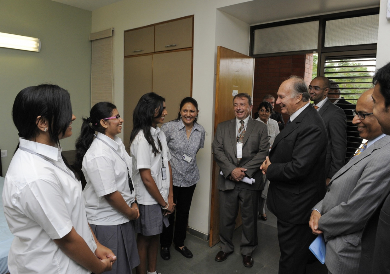 Mawlana Hazar Imam meets some of the students of the Aga Khan Academy, Hyderabad, during a tour of the student housing quarters. (Hyderabad, 2013) AKDN / Gary Otte