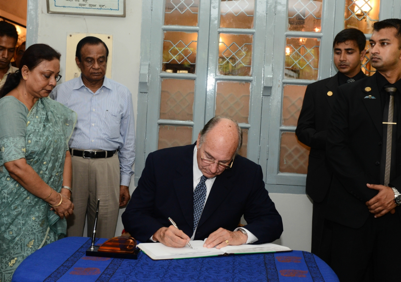 Mawlana Hazar Imam signs a visitors book at the Bangabadhu Memorial Museum, the former residence of Bangladesh's founding leader, the Father of the Nation, Sheikh Mujibur Rahman.