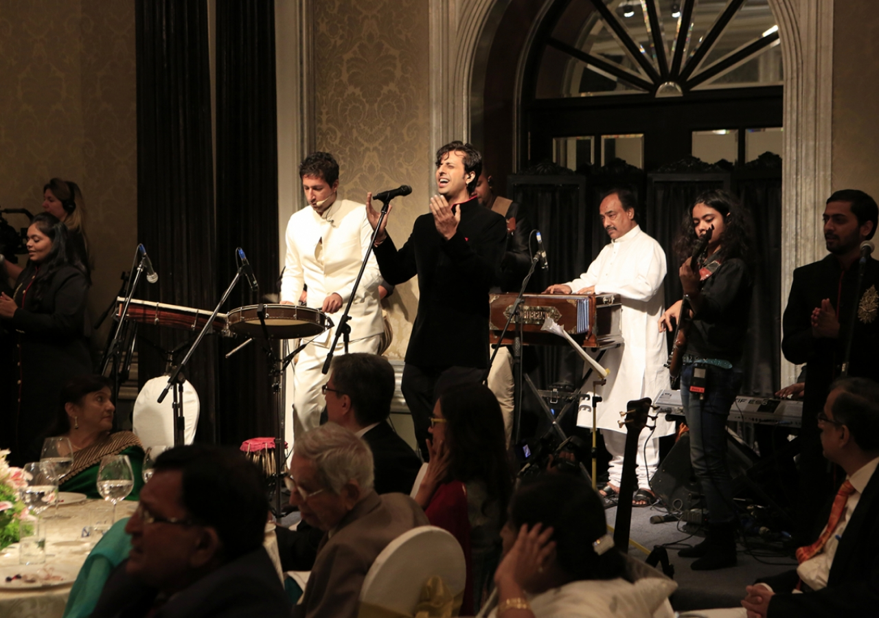 At the institutional banquet, musicians Salim and Sulaiman, accompanied by six youth from across India, perform before the Imam and the Jamati leadership.