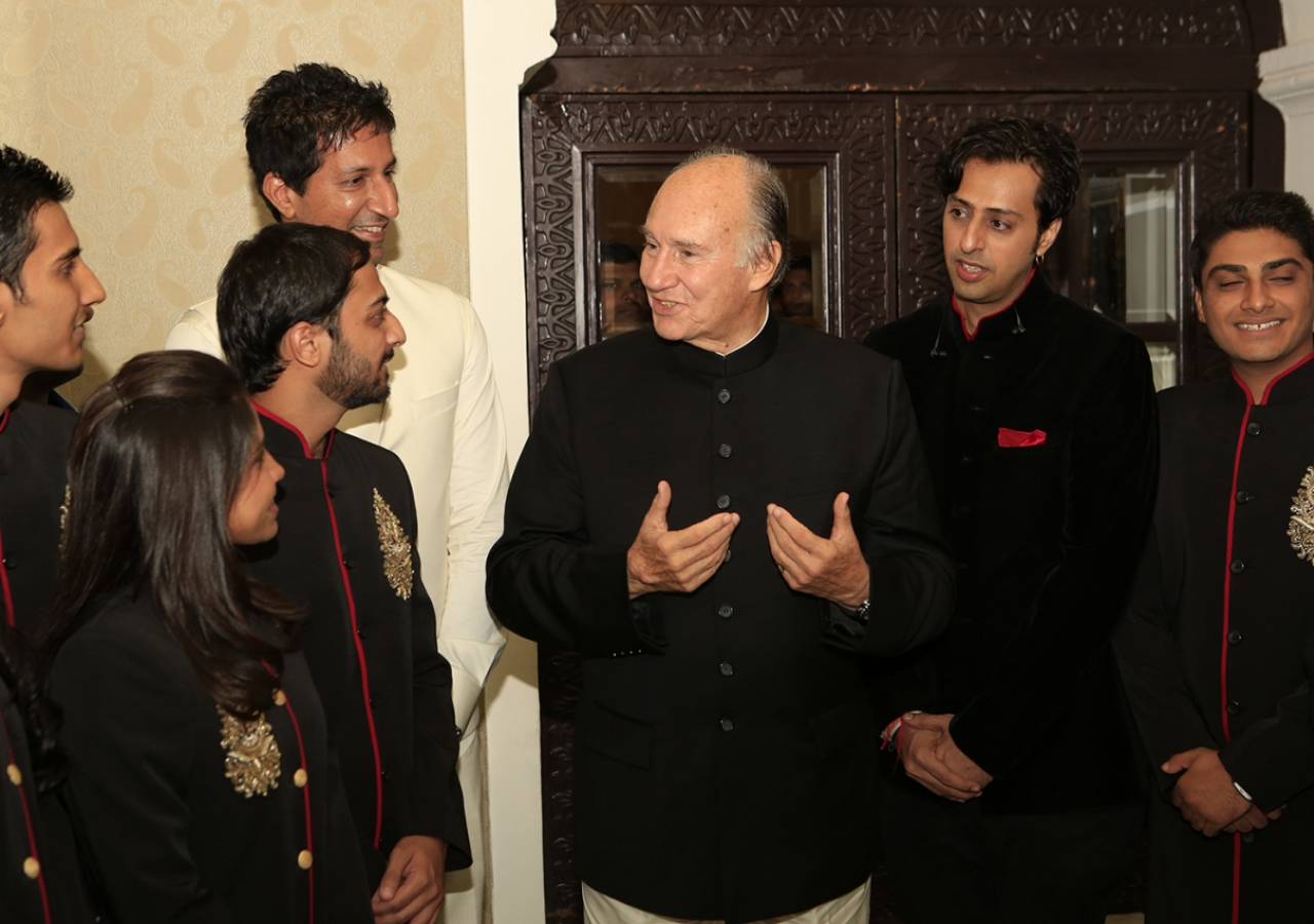 Mawlana Hazar Imam speaks with murids who performed at the institutional banquet.
