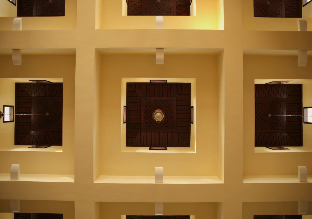 Chandeliers hang from a coffered ceiling inside the Ismaili Jamatkhana and Centre, Kinshasa.