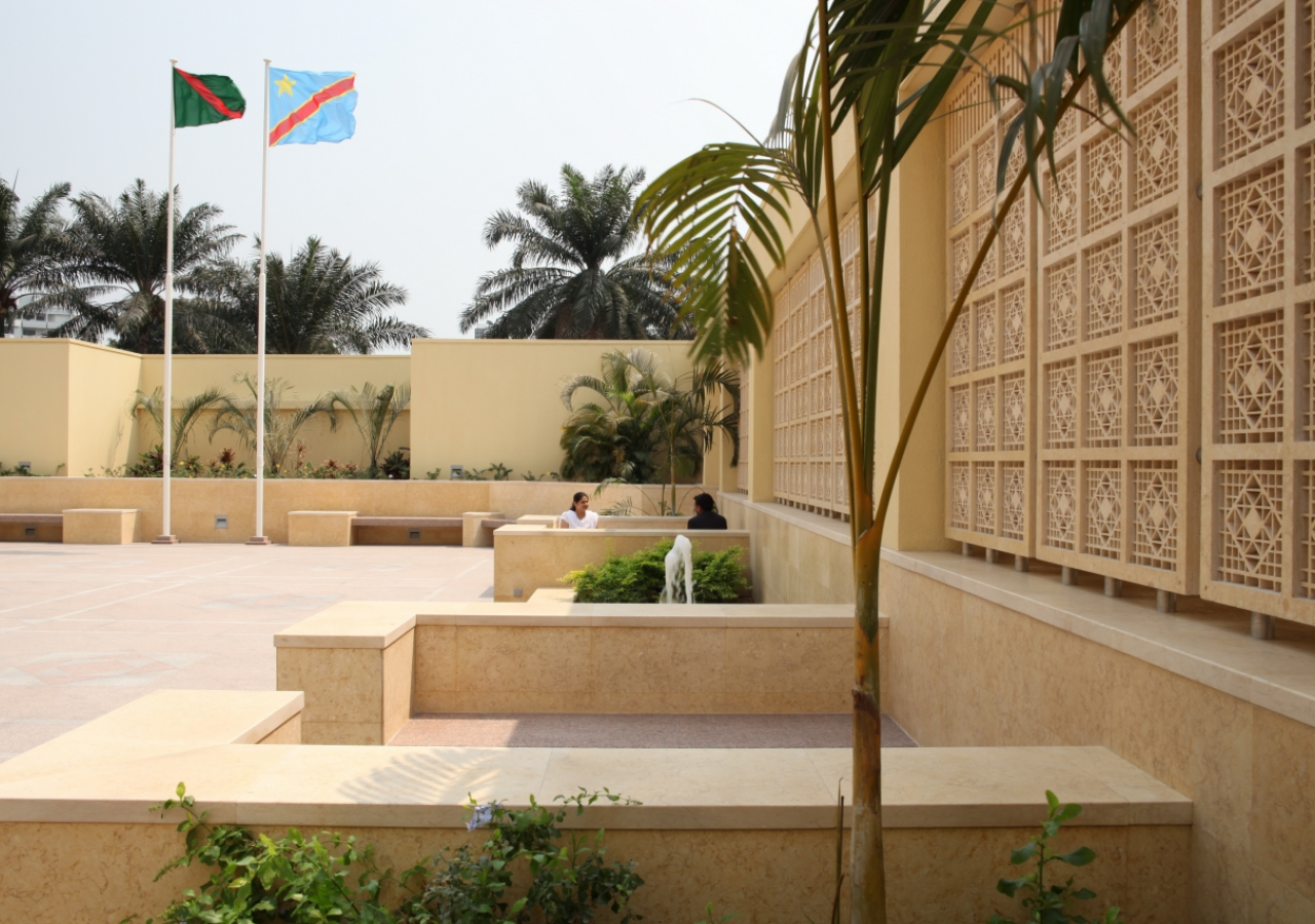 Two flagpoles stand at the end of the Grand Courtyard of the Ismaili Jamatkhana and Centre, Kinshasa.