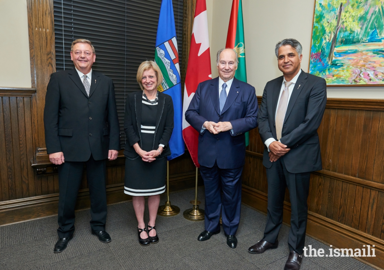 Mawlana Hazar Imam and Alberta Premier Rachel Notley pose for a photograph with Mr. Lorne Dach, Member of Legislative Assembly, Edmonton-McLung, and Irfan Sabir, Minister of Community and Social Services.