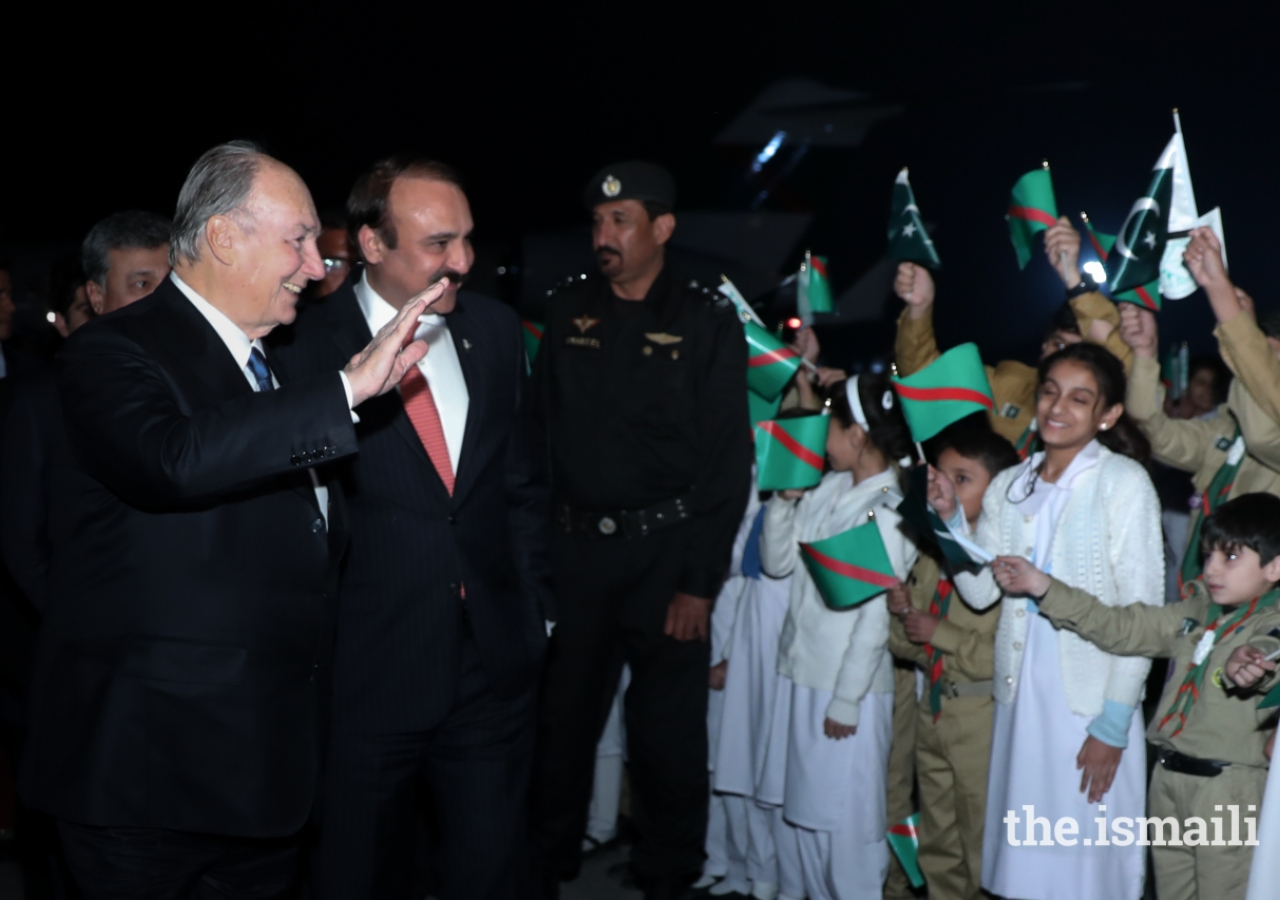 Mawlana Hazar Imam waving happily at the jubilant shaheen scouts and junior guides upon his arrival.
