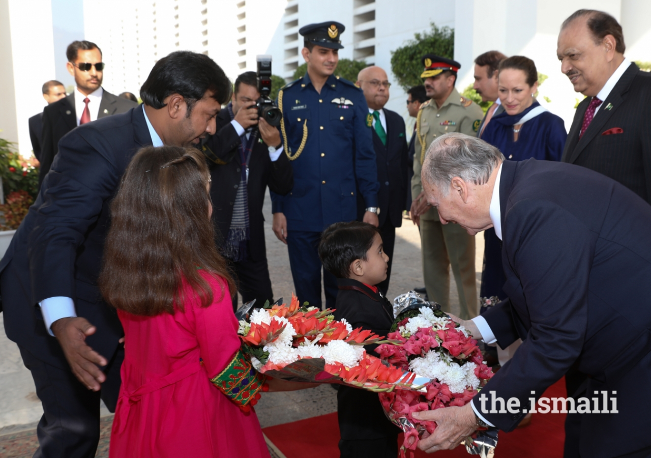 Mawlana Hazar Imam receives a bouquet of flowers upon arrival at the Aiwan-e-Sadr