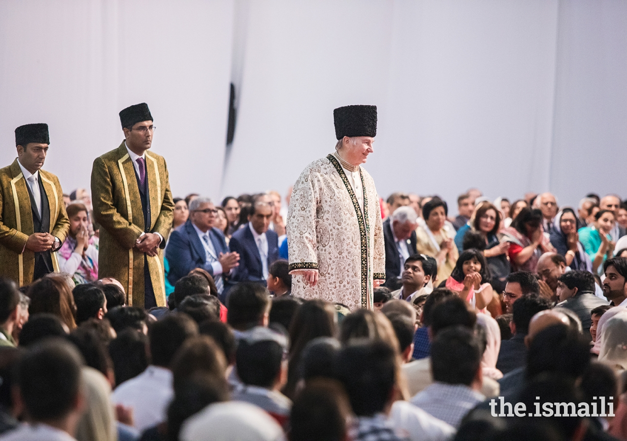 Mawlana Hazar Imam walks through the Jamat during the Diamond Jubilee Darbar in Dubai.